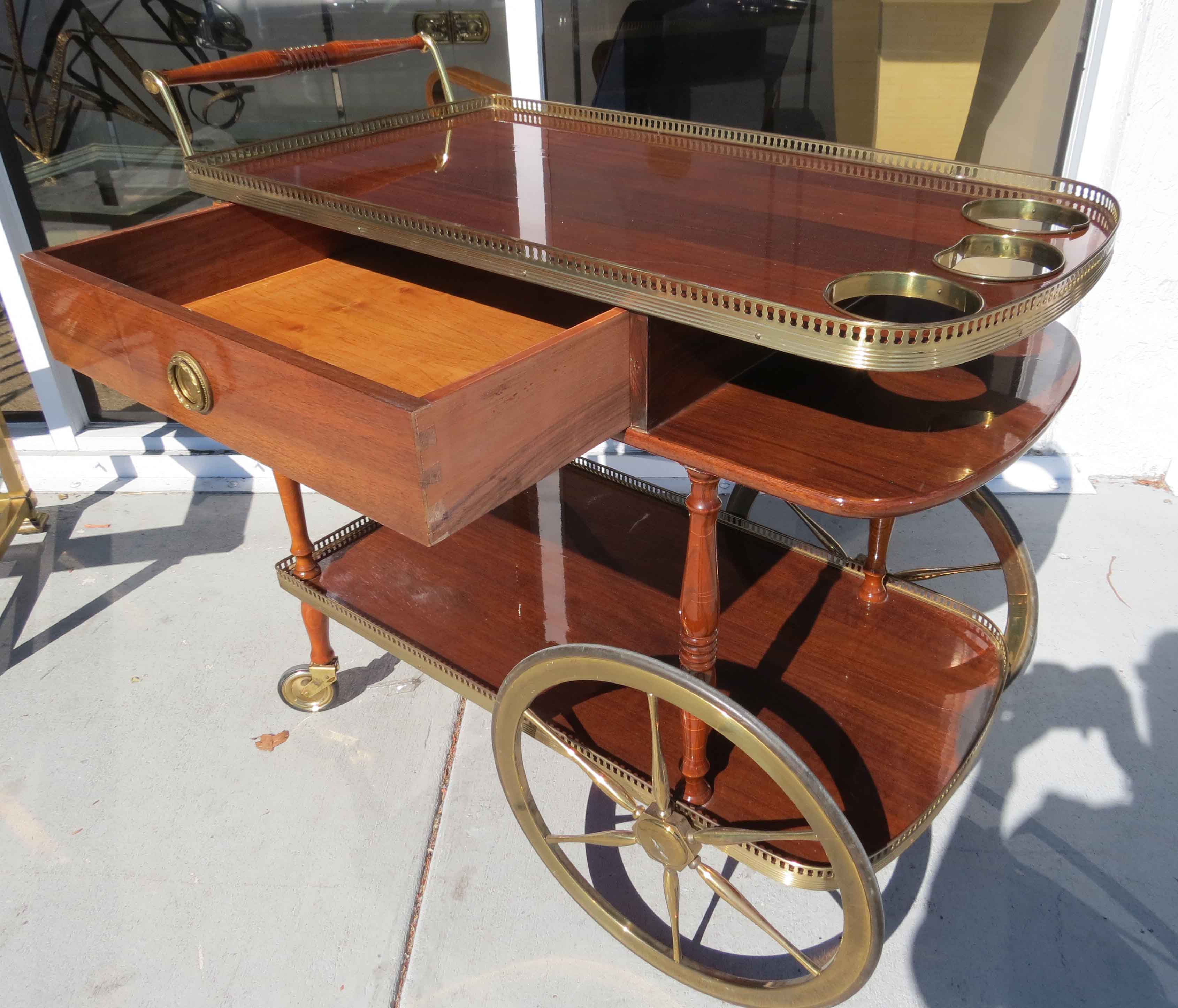 A Sixties Wood And Pierced Brass Wheeled Bar Cart Modernism