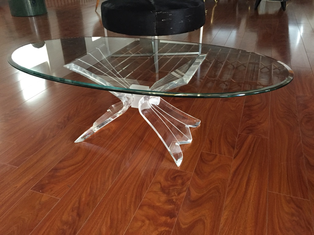 mid-century coffee table with lucite base and glass top | modernism